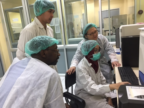 Lab workers and researchers working on vaccines.