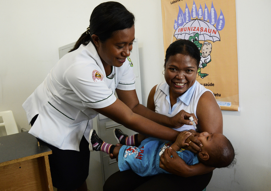 baby Sergio Sarmento receives polio drop vaccination at Vera Cruz Community Health Centre Dili