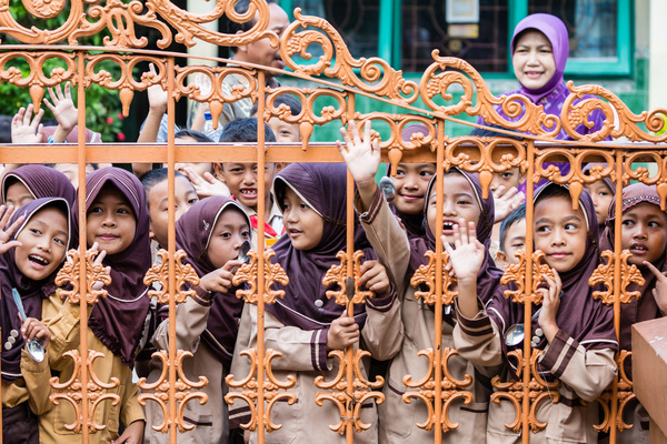 Children wait for the start of the LF MDA in Pekalongan City, Indonesia.